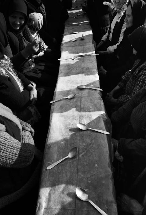 Nikos Economopoulos, Dinner held after a funeral, Maramures, Romania, 1990.
