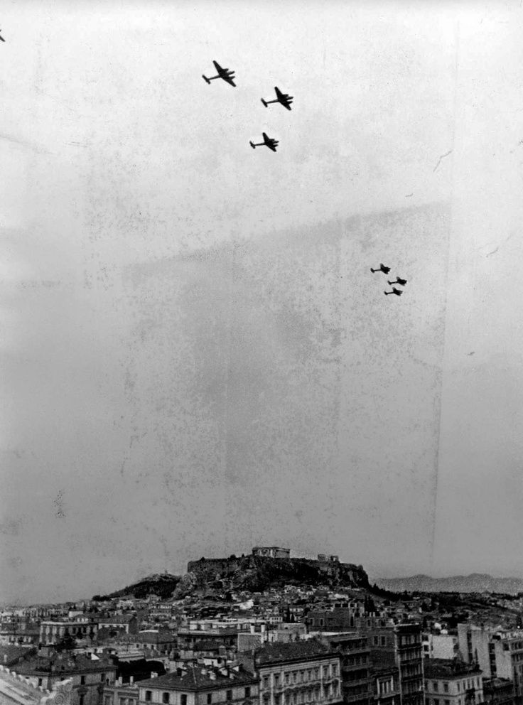 German Bf 110 fighter aircraft flying over the Parthenon in Athens, Greece in the autumn of 1941. Athens was occupied between April 1941 and October 1944.