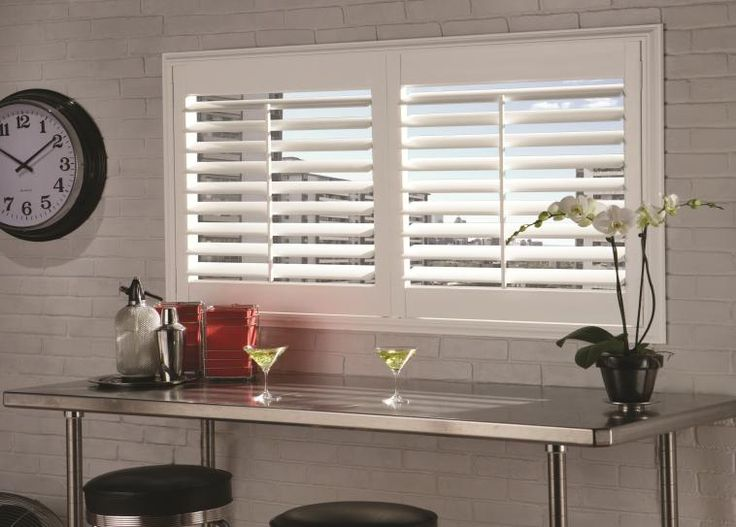 Plantation shutters create a cool vibe in this retro kitchen.  See our shutter style at www.budgetblinds.com/walnut creek