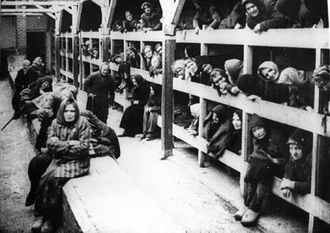 Inside a wooden barrack in Auschwitz II-Birkenau camp. Liberated female prisoners. The image comes from the film documentation made by Soviet army.