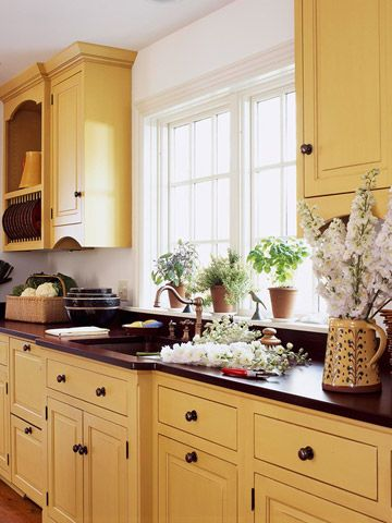 Courageous Yellow-Feeling that natural wood-tone cabinetry would be too dark for their kitchen, especially during the minimal daylight of Midwestern winters, these homeowners chose cherry cabinets with a golden yellow painted and glazed finish. Now, no matter what the time of day -- or time of year -- stepping into this kitchen is like walking on sunshine.