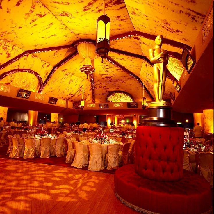 From Sequoia Productions: 2001 Governors Ball: Making its final appearance in the Shrine Expo Hall, the 73rd Governors Ball was themed 'Victorian'. This design featured custom 7 foot tall chandeliers with a rotating appliqué inside, ornate mirrors, and over 2000 square feet of hand painted silk.