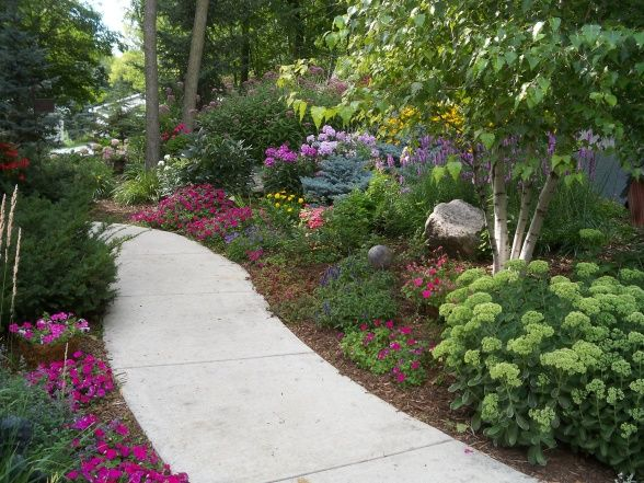 summers reward a one acre lot full of annual and perennial beds in minnesota - Flower Garden Ideas Minnesota