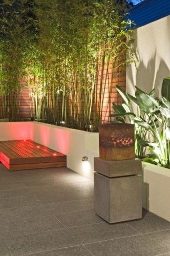 Raised planter with bamboo around the deck for privacy..also lighting gives it a nice feel