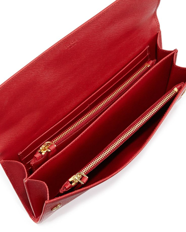 "Prada saffiano travel wallet. Golden hardware; front logo decal. Double-snap flap front. Two zip pouches. Divided inside with eight card slots. Back slit pocket for bills. 5""H x 9 1/4"" W x 1""D; bag we"