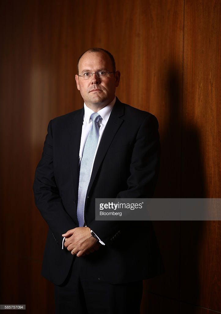 Graham Shuttleworth, chief financial officer Randgold Resources Ltd., poses for a photograph ahead of a news conference to announce the company's half-year results at the London Stock Exchange in London, U.K., on Thursday, Aug. 4, 2016. Randgold Resources is fighting to meet its full-year production target after operational problems at two of its African mines led to lower gold output and profit. Photographer: Chris Ratcliffe/Bloomberg via Getty Images