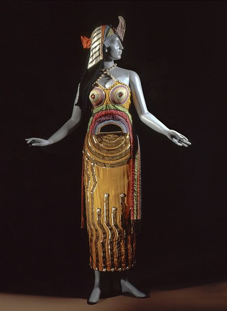 Sonia Delaunay (Russia, Ukraine, 1885 - 1979)   Costume for 'Cléopâtre' in the Ballets Russes production of 'Cléopâtre' (Cleopatra), 1918  Costume/clothing accessory/headwear; Costume/clothing principle attire/entire body, Silk, sequins, mirror and beads, wool yarn, metallic thread braid, lamé, a) Dress center back length: 45 1/8 in. (114.62 cm); b) Headdress: 22 11/16 x 14 5/8 x 12 5/8 in. (57.63 x 37.15 x 32.07 cm)  Costume and Textiles Department. Los Angeles County Museum of Art.