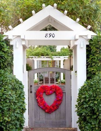 Gorgeous gate and lovely greenery around it. I like it better than flowers.