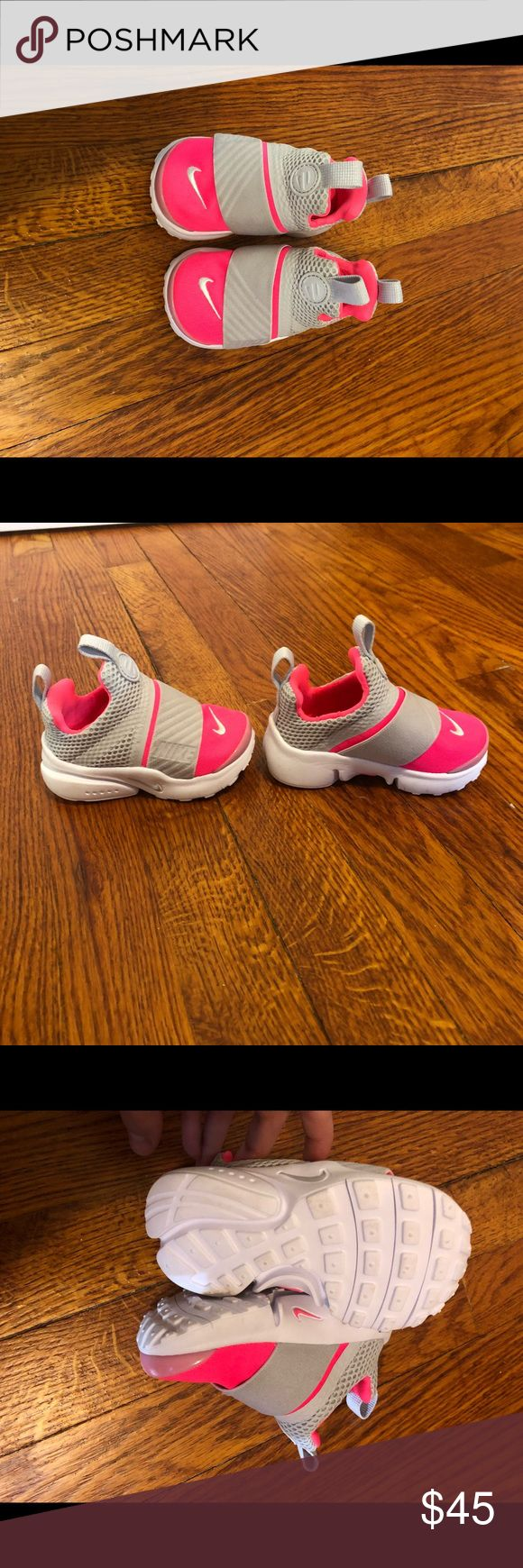 Brand new size 6 toddler Nike shoes. Perfect condition, never used. Color is light gray and hot pink. Nike Shoes Athletic Shoes