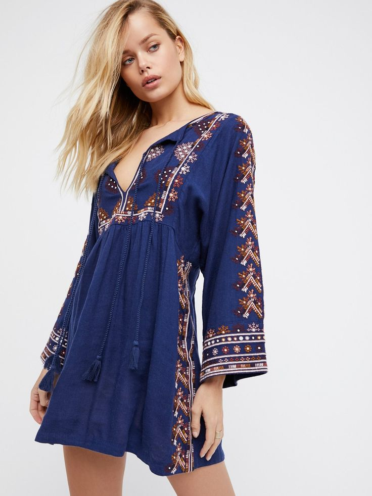 Starlight Mini Dress | Embroidered mini dress with a beautiful bohemian feel. Features a center cutout with adjustable tie accents. Easy shape with wide, relaxed sleeves.