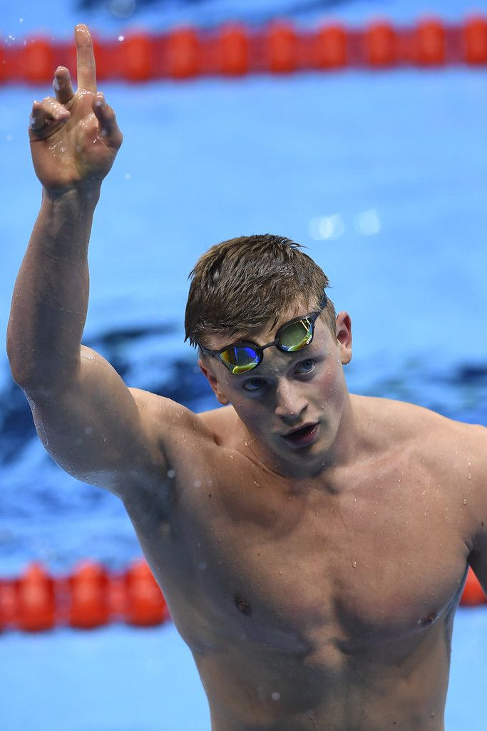 Britain's Adam Peaty reacts after he broke the world record in the Men's 100m Breaststroke heat during the swimming event at the Rio 2016 Olympic Games at the Olympic Aquatics Stadium in Rio de Janeiro on August 6, 2016.   / AFP / GABRIEL BOUYS
