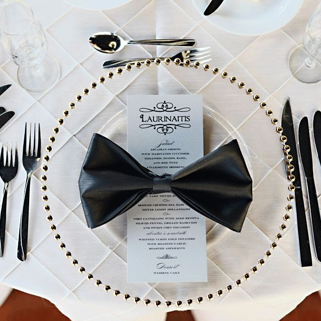 Sleek and Simple Bow-Tie Napkin Place Setting // Henry Photography // http://www.theknot.com/weddings/album/a-formal-modern-wedding-in-columbus-oh-146657