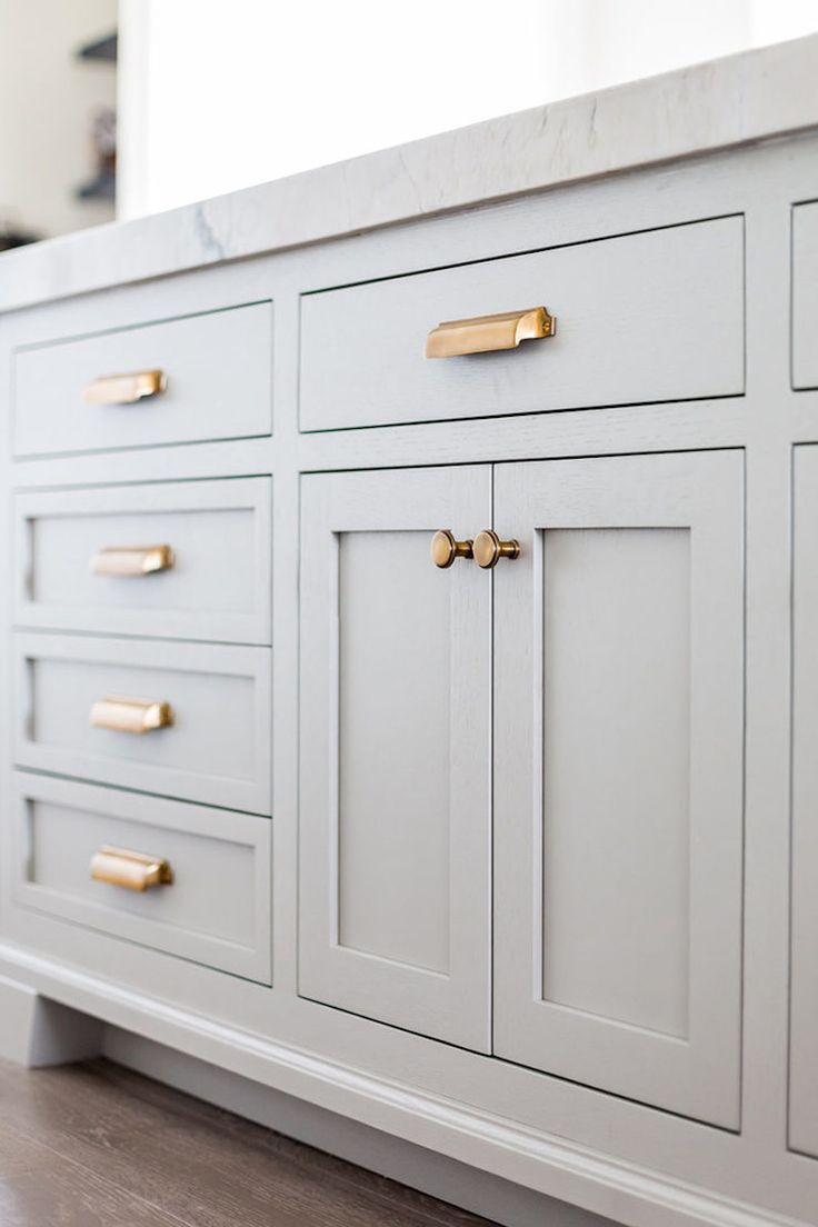 This is such a great look for a Dresser or Kitchen unit. White, Marble and Gold Hardware.