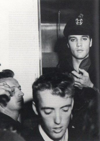 """Elvis (Richard Davis in the foreground  and Red West on the left) photographed at the Columbia Inn Motel, Kalama, Washington, Tuesday, September 4, 1962  