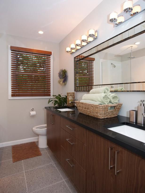 Pictures In Gallery The master is now modern with neutral Terrazzo tile floors and a custom vanity with under mounted his and hers sinks A beautiful mirror lined with tiny