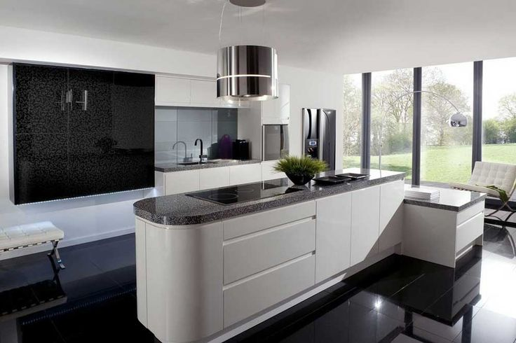 Kitchen tiles black with floating black glossy cabinets to go also marble charming table top and white island with dining chairs