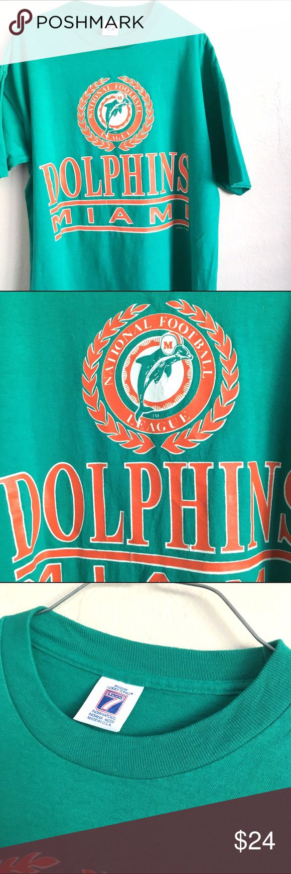 """Vintage Miami Dolphins T shirt Up for sale is a vintage Logo 7 Miami Dolphins T shirt. Awesome aqua green color shirt. Size is  XL -100% cotton- width is 24"""" across and 27"""" in length. Never worn. The cracks in some of the art is from being folded in storage . logo 7 Shirts Tees - Short Sleeve"""