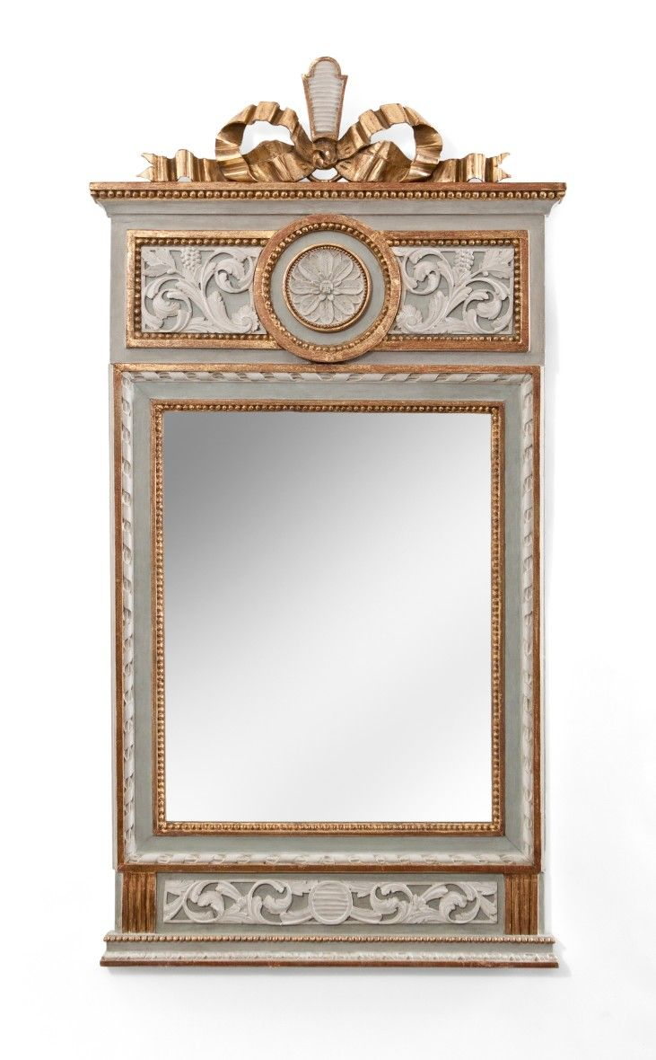 A Swedish Gustavian Period Painted and Parcel Gilt Mirror - Late 18th Century - The rectangular mirror plate within a beaded and ribbon-twist border, surmounted by a ribbon crown and a frieze centered by a rosette flanked by arabesque scrolls, terminating in reserve with scrollwork over a molded base. Dimensions: Height: 46.5 in, Width: 24.5 in / Height: 118.1 cm, Width: 62.2 cm.