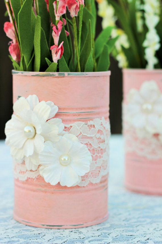 These two re-purposed tin cans are painted in a pink chalk paint and adorned with paper flowers and lace trimming. Created in a shabby chic