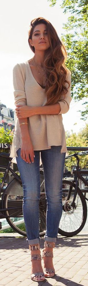 I like the jeans, the fit, the mild distressing. The loose comfortable top is appealing.