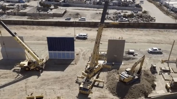 US Customs and Border Protection recently released video of President Trump's border wall prototypes in San Diego. And we couldn't help but notice something strange from the video. It shows a bird's-eye view of the wall from the perspective of a drone. And the drone is much, much higher than the wall.