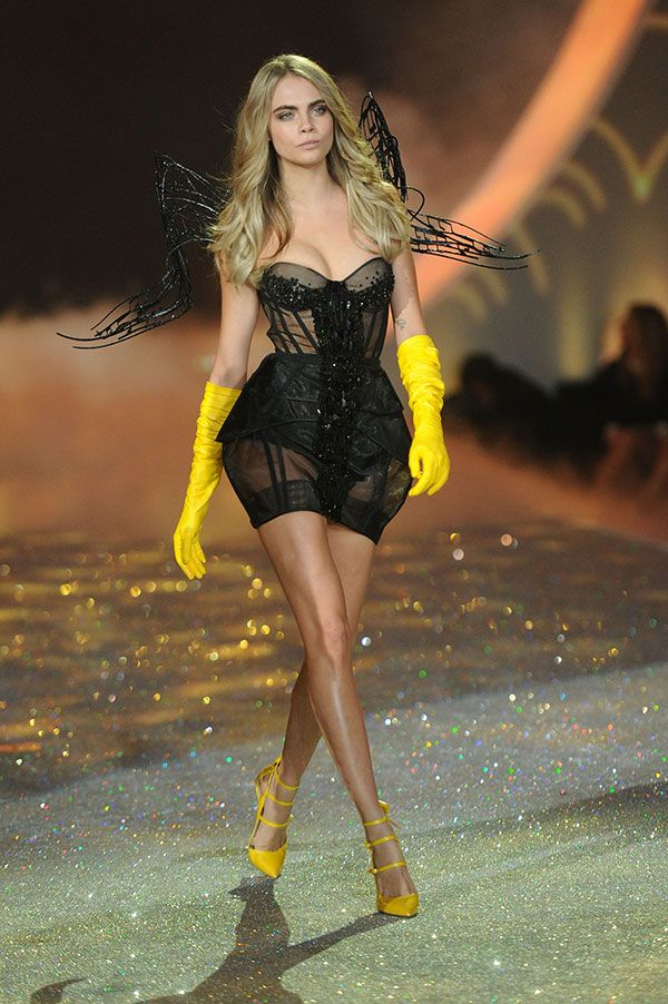 Hmmm not sure how I feel about rubber gloves on the catwalk... Well I suppose if someone can it's Cara Delevigne