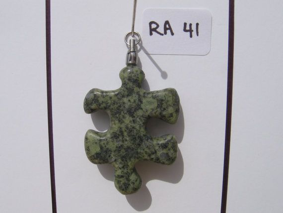 The symbol for Autism is a puzzle piece, and is very fitting as Autism is a puzzling syndrome for sure. Having two boys (7 and 8) on the spectrum makes this cause very near and dear to my heart. Each Autism Awareness Pendant is attached securely to Resonated Rocks Signature Swivel and spins fluidly and freely. Each pendant is completely one-of-a-kind.    *Hand collected rocks from the beaches on the southern tip of Vancouver Island in the Pacific Northwest region of Canada.    *Each stone is…