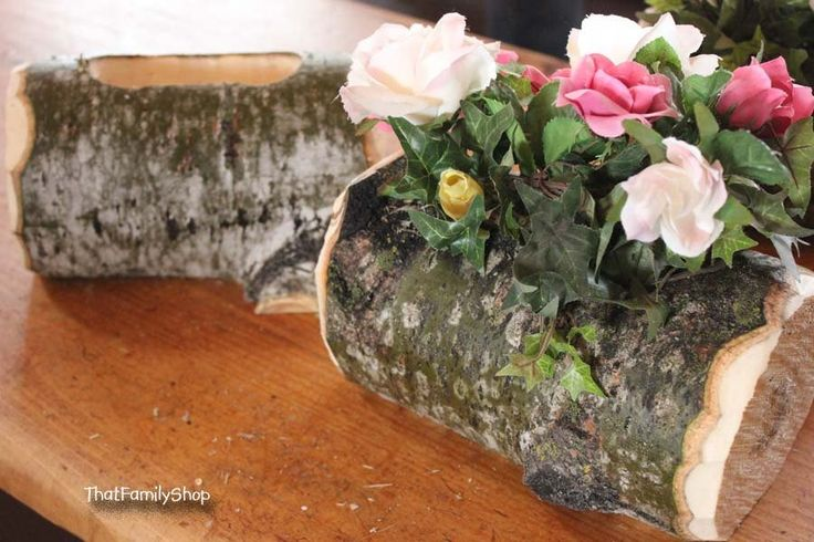 Ultra-rustic wedding centerpiece! You can't get much more rustic than the log itself. :o) These logs have been flat-sided to lay horizontally on the table, and their edges have been chipped away for a