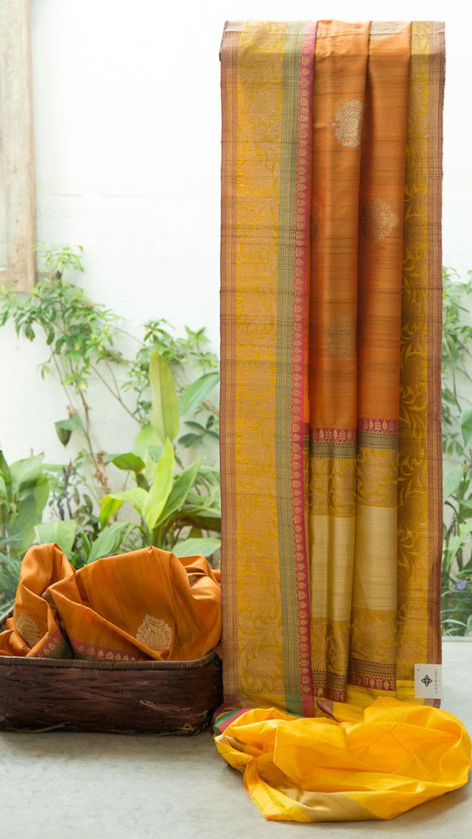 Ravishing yellow benares tussar silk with alternating floral motifs in gold and silver on the body. The pallu is a combination of yellow, pink, gold and purple colours. The intricate floral design ...