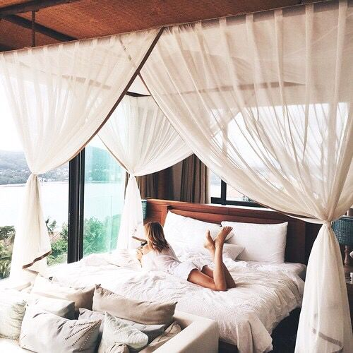 I love the big canopy and couch at the end of the bed and really just the whole thing