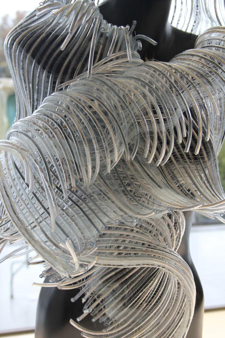 RMIT University, Textile design and development. Jessica Coetzer. Encompassed. Nylon Monofilament. Transparent vinyl tubing. Yarn.  Photography by Douglas McManus.  #RMIT #CreativeFest