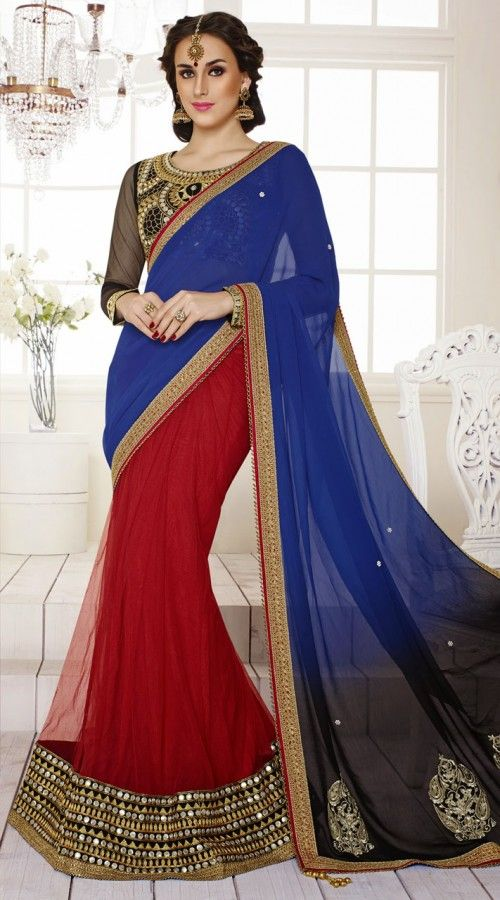 Fashionable red and blue faux georgette, net lehenga style saree which is crafted with a mirror, gold work on the first half in the horizontal panel, resham work on the pallu and zari lace work on the border. Contrast black embroidered blouse piece attached with this outfit. The blouse of this Lehenga saree can be stitched in the maximum bust size of 42 inches.
