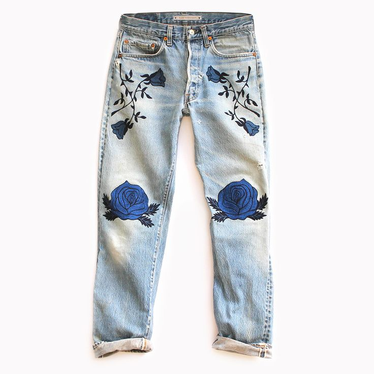 Combining elements of vintage Hollywood western wear with a modern color  palette and design, The Conjure Flower Denim features chain stitch  embroidery in medium blue and navy on an authentic pair of vintage Levis  501s.  This item is Made to Orderin approx. 4 weeks from purchase date.  CONTENT + CARE - Cotton - Dry Clean - Made in the USA  SIZE + FIT -Medium to high-rise - Relaxed, slightly tapered leg - For a lower rise fit that is loose through the hip and bum, order 1-2  sizes larger…