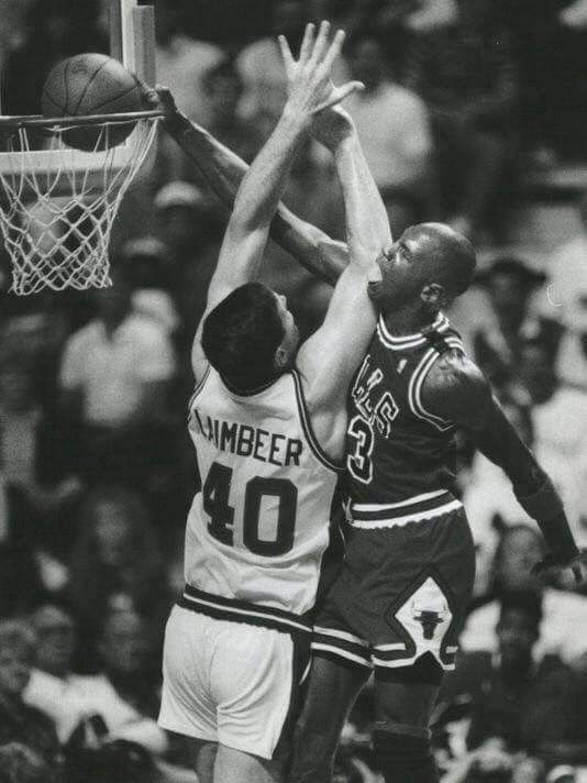 Michael Jordan dunking on Bill Lambier