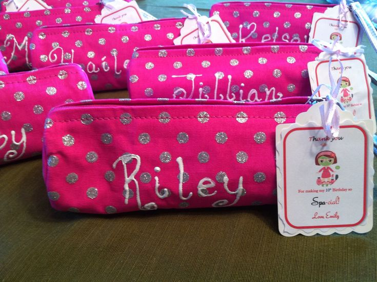 "Just finished up ""goodie bags"" for my daughters 10th birthday party that we are having at a spa..filled them with a lot of goodies girls love!, eye shadow, feather hair extensions, lip gloss, nail polish, friendship bracelet & of course candy..Added their names on them & made a cute gift tag."