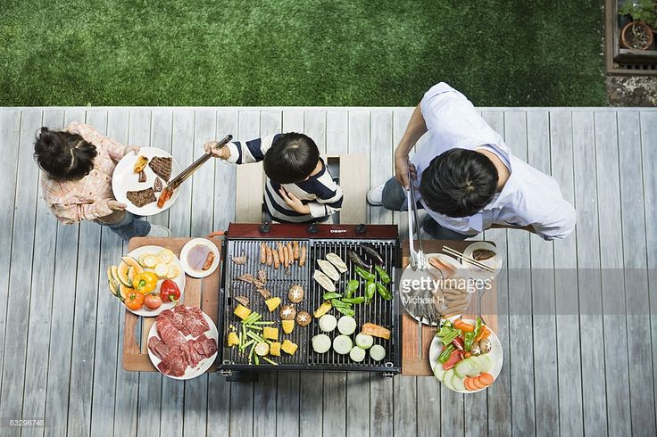 Stock Photo : Man and boy cooking barbecue for family