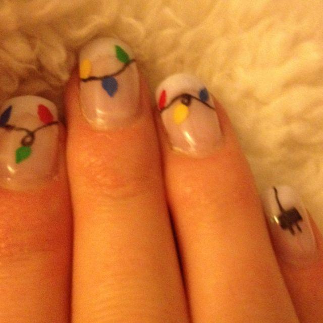 Holiday fingernails. I love the plug on the pinky