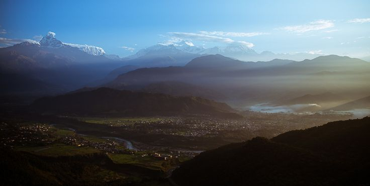 A view of the Annapurna Mountain range in Nepal, as seen from above Pokhara as the morning sun begins to fill the valley. By Luke Barker at www.tronorphic.com.