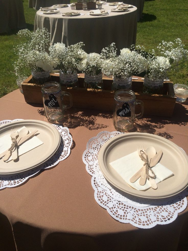 Elegance on a budget - disposable plates, flatware and paper doilies with economical and lovely babies breath at Agua Linda Farm