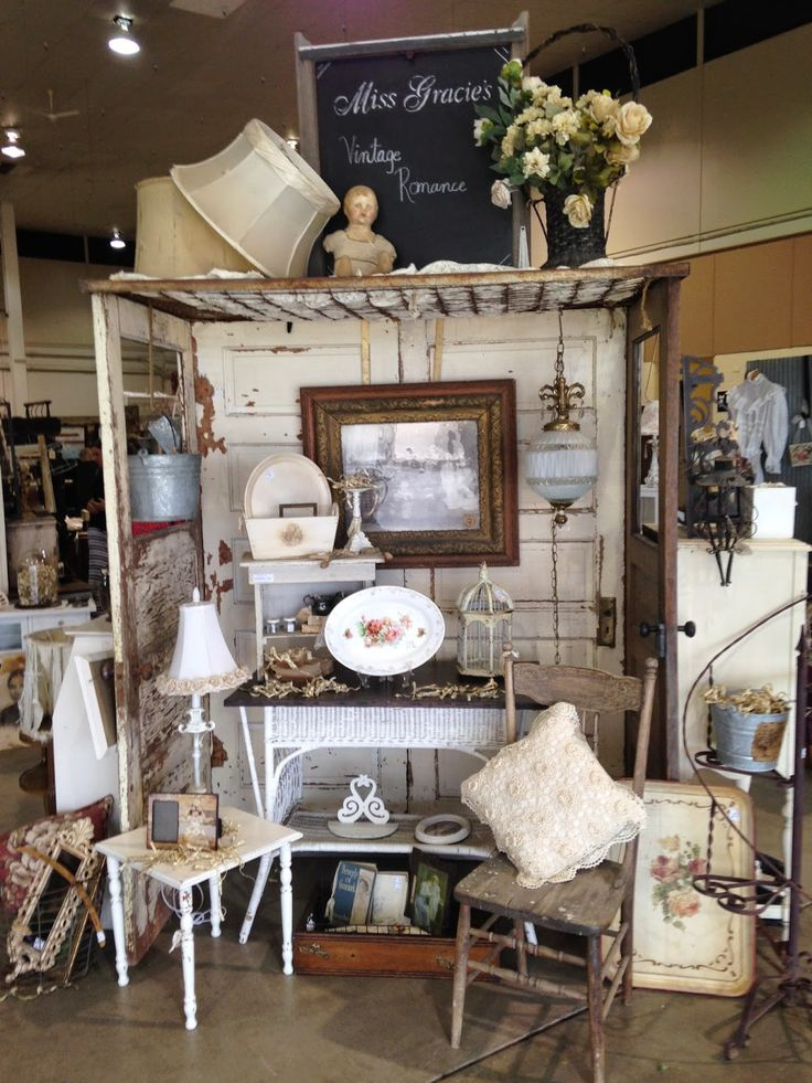Love this display made from old doors and a bed spring