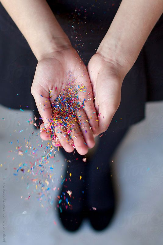 Girl catching colourful pencil shavings in her hands by jacquelinemiller | Stocksy United