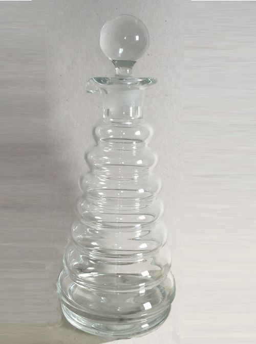 Clear glass decanter by Thomas Webb. Very modern but probably late 19 C made up of rounded band upon band. A very fun piece crying out for a drink though