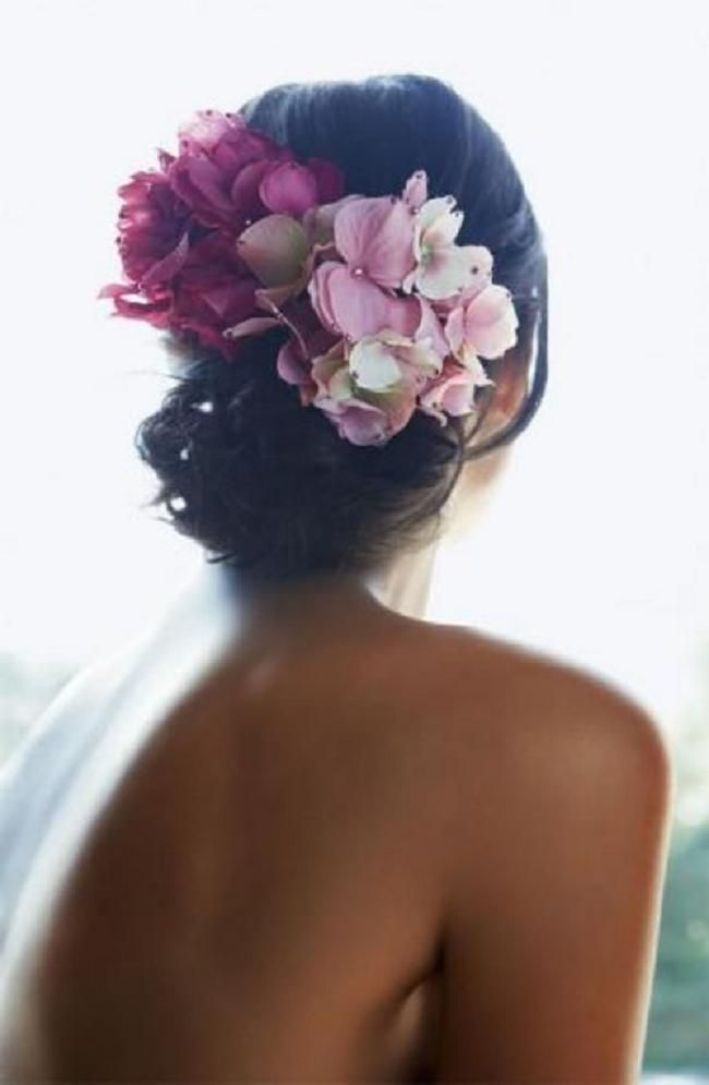 Hydrangeas make a beautiful hair do for a wedding.