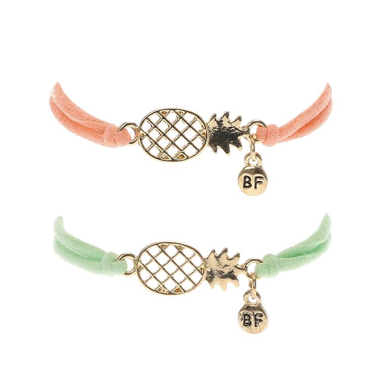 <P>This pack of two best friend bracelets include a pale peach and mint green cord bracelet adorned with a gold-tone filigree pineapple pendant which a circle BF charm</P><UL><LI>2 pack <LI>Gold-tone finish <LI>Adjustable</LI></UL>