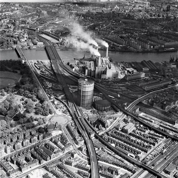 A prospect of #London from the air as it was in 1953 showing Battersea Power Station when it only had three chimneys.