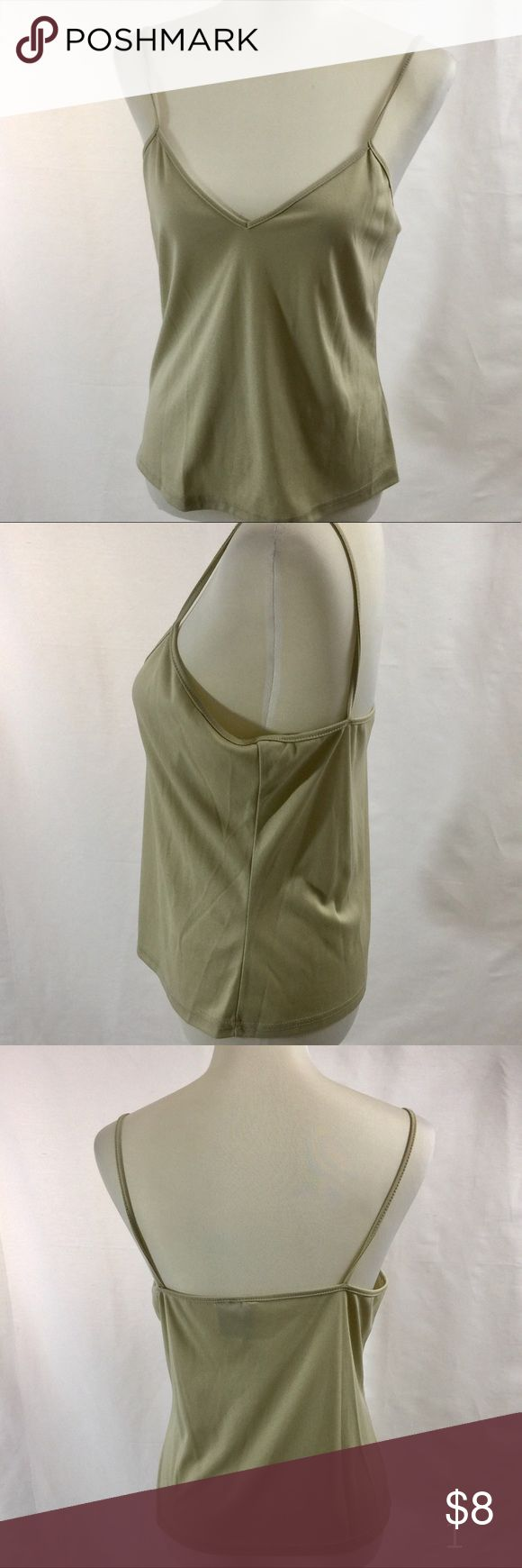 """New Directions Solid Light Gold Cami Adorable alone or as a seamless layering piece, our Cami is a wardrobe must have. V neck neckline adjustable spaghetti straps fitted hits at the hip approx. 19""""-20"""" length 100% Polyester washable new directions Tops Camisoles"""