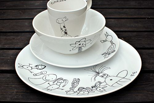 white plates, child's drawings, transfer paper and porcelain marker = great idea!