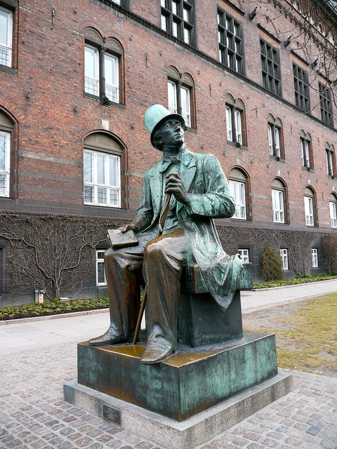 Copenhagen, Denmark: statue of Hans Christian Andersen.You can see how the pants shine...lots of people sit on his lap to have their photo taken.