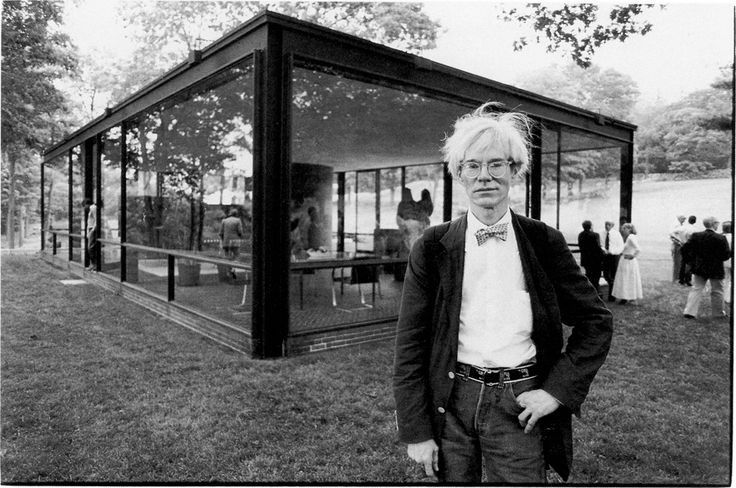 Andy Warhol in front of Philip Johnsons Glass House, New Canaan, Connecticut, 10 June 1981. Photo by Christopher Makos.