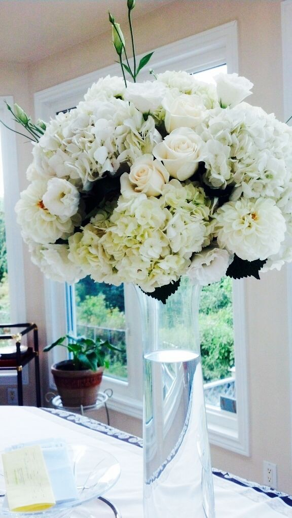 Tall wedding centerpiece. Toronto/GTA florist #white #floral #clear #vase